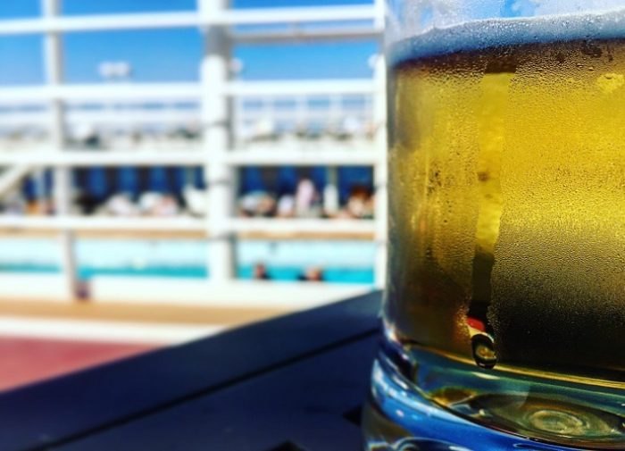 Glass of cold beer on the deck of Silver Muse