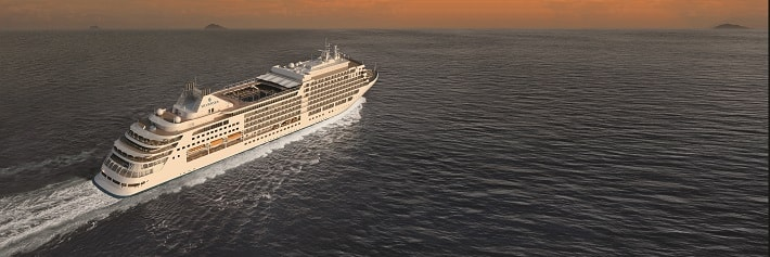 Silversea Silver Muse sailing across the ocean at sunset