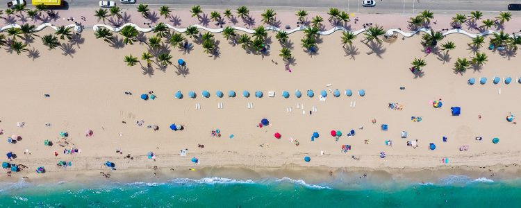Aerial view of sun loungers and travellers on a Miami beach