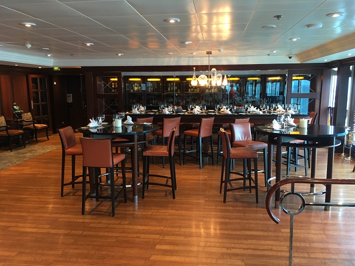 Traditional wooden decor in Azamara Quest Prime C