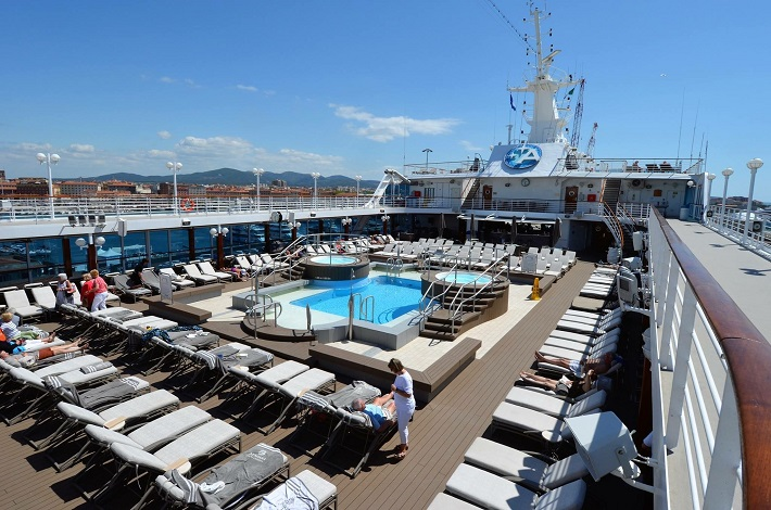 Pool and sunbeds on the Azamara Quest sun deck