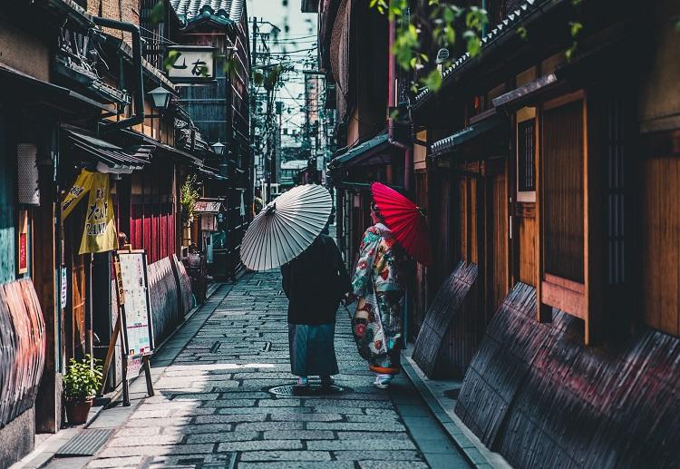 Geisha girls strolling down a street in Japan