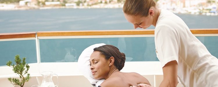 Guest receiving a massage on a private deck on-board Seabourn Encore