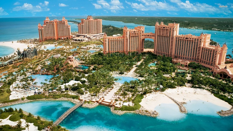 Panorama of a Bahamas resort rising up out of the bright blue sea
