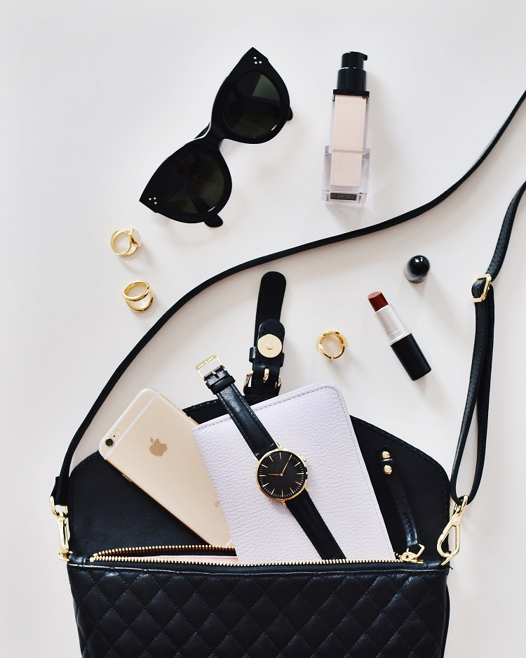 Chanel handbag, sunglasses and lipstick after a shopping trip in Paris