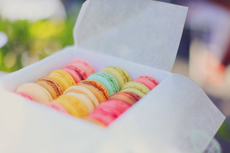 A white box of colourful macarons from a shop in Paris