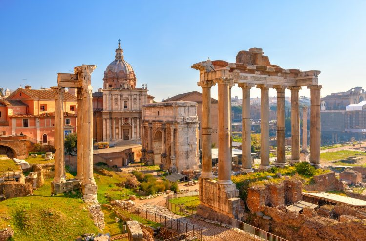 Ancient ruins in Rome's Roman Forum, bathed in sunshine