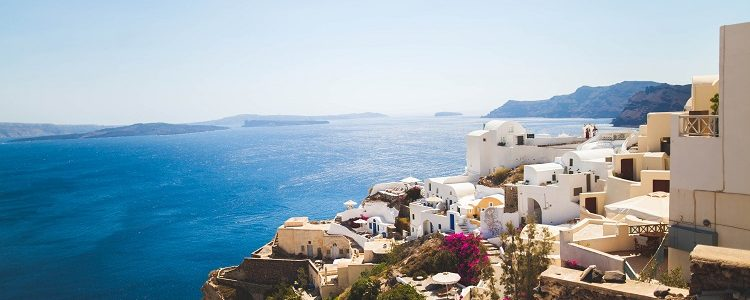 Houses and apartments on a sun-soaked cliffside in Santorini cruise port