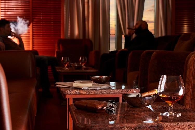 People smoking cigars in Connoisseur's Corner on-board Silver Muse