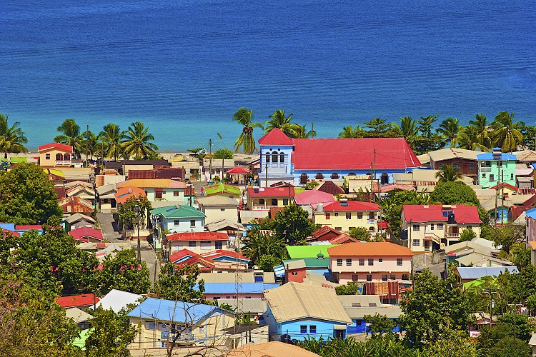 Colourful houses lining the streets leading down to the sea in St Lucia