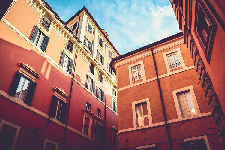 Houses and apartment buildings in Rome cruise port, bathed in sunshine