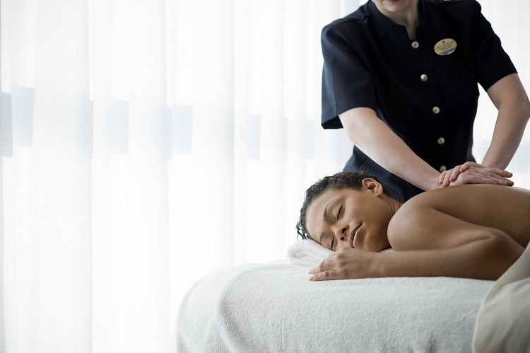 Woman having a massage treatment in the spa on-board Celebrity Eclipse