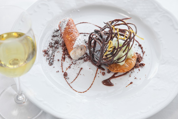 Cannoli dessert with chocolate sauce on-board a Crystal Cruises ship