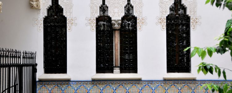 Tiles and carvings in the courtyard of Palau Macaya in Barcelona