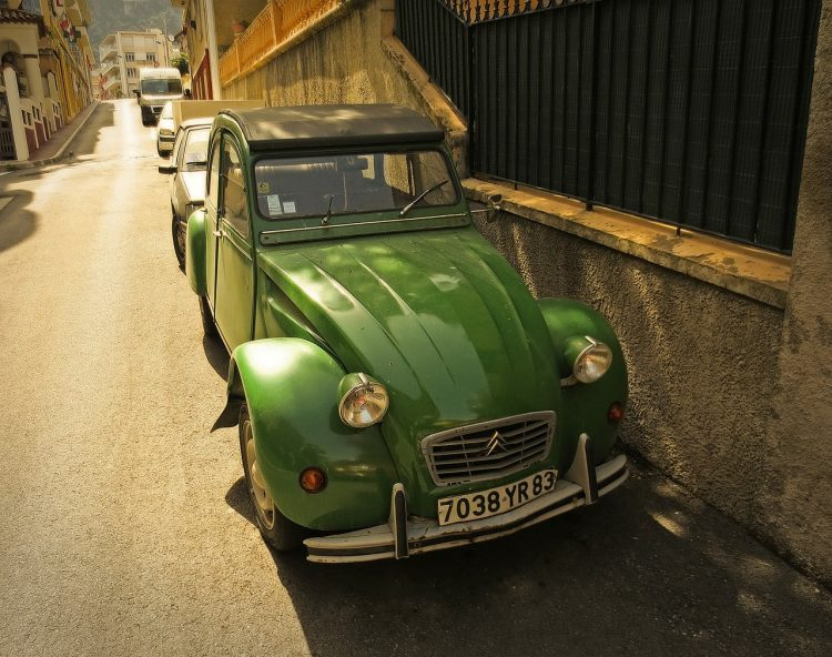 A green Citroen 2CV parked in the Old Town of Villefranche-sur-Mer