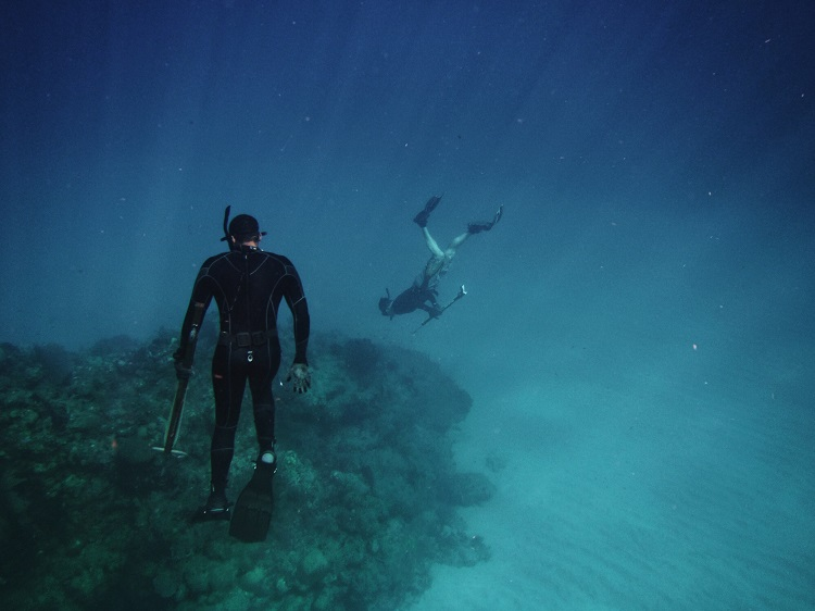 A couple snorkelling with selfie sticks in the sea off Cuba