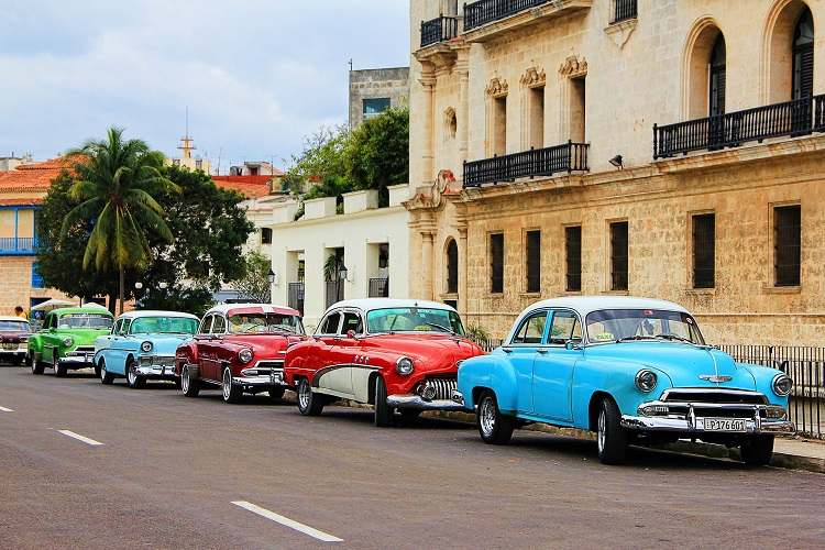 Classic cars lining a street of colonial buildings in Havana