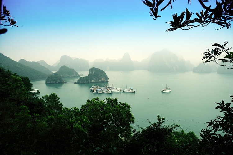 Hazy mist settling over the boats and islands in Halong Bay
