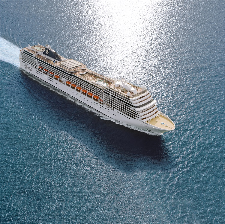 An MSC cruise ship sailing across the glittering ocean