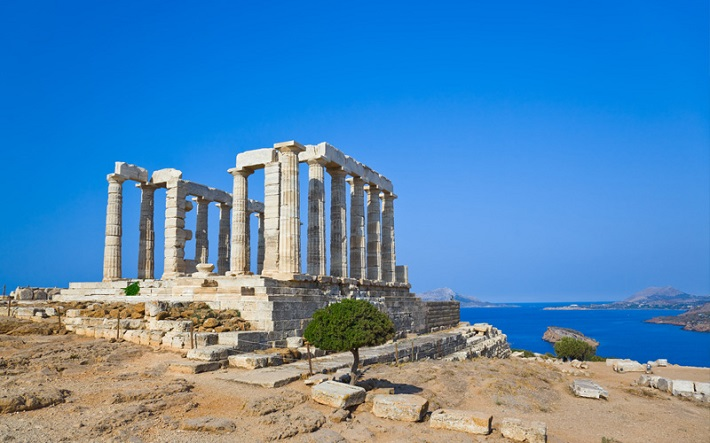 Greek ruins on a hillside overlooking the ocean in Athens