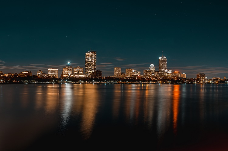 Boston Harbour shining a reflection into the sea at night