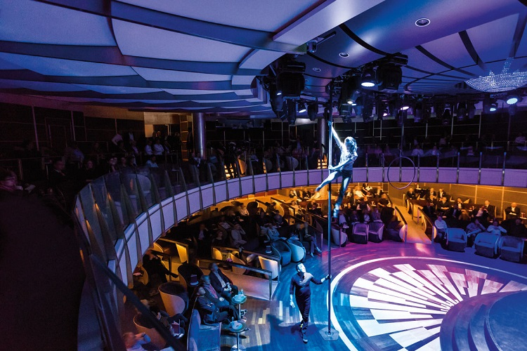 Gymnasts performing to a packed theatre on-board Hapag-Lloyd's Europa 2