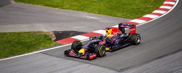 A Red Bull race car soaring around a track during the F1 Grand Prix