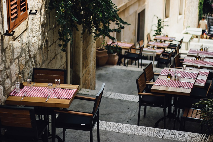 Chairs and tables in a quaint restaurant in Hvar, Croatia