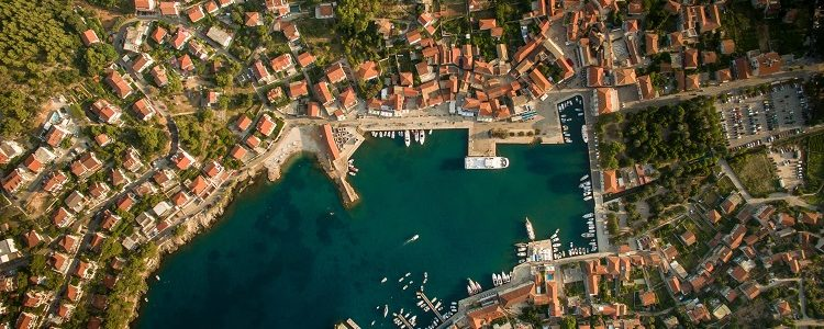 A panoramic, aerial shot of Jelsa in Croatia and the surrounding bright blue sea
