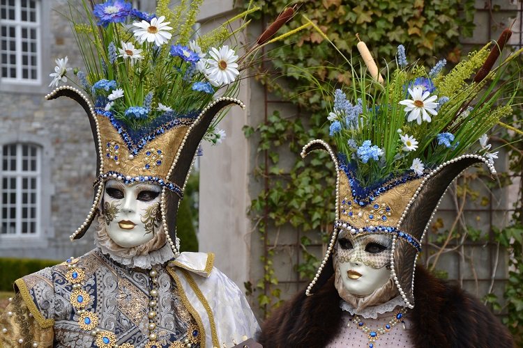 A couple in Venice wearing elaborate carnival masks