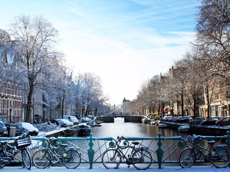 A snow-covered bridge in Amsterdam at Christmas