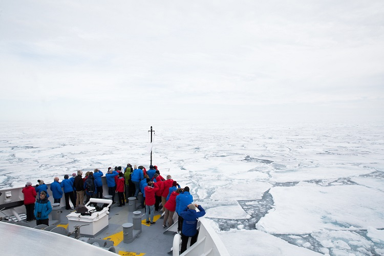 A Silversea expedition cruise breaking through ice in Spitsbergen in the Arctic
