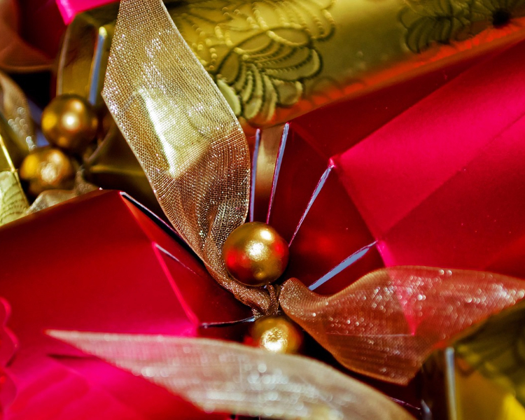 Christmas crackers wrapped in bells and ribbons