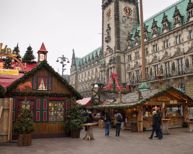 Tourists walking around a Christmas market in Hamburg