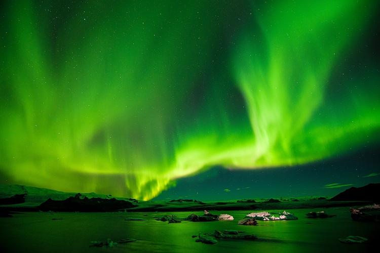 Vast, bright green Northern Lights shining over Iceland