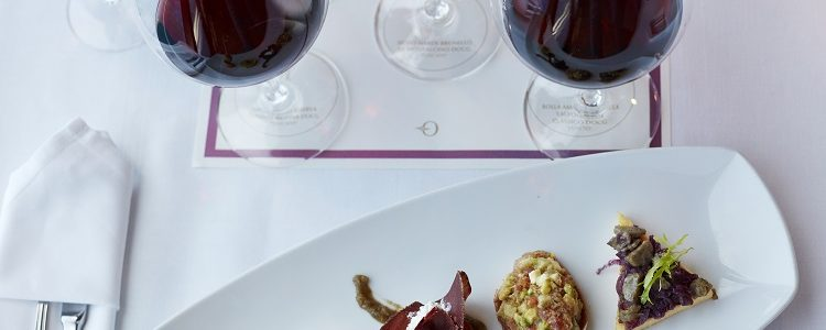 Wine tasting and canapes on a table on an Oceania Cruises ship