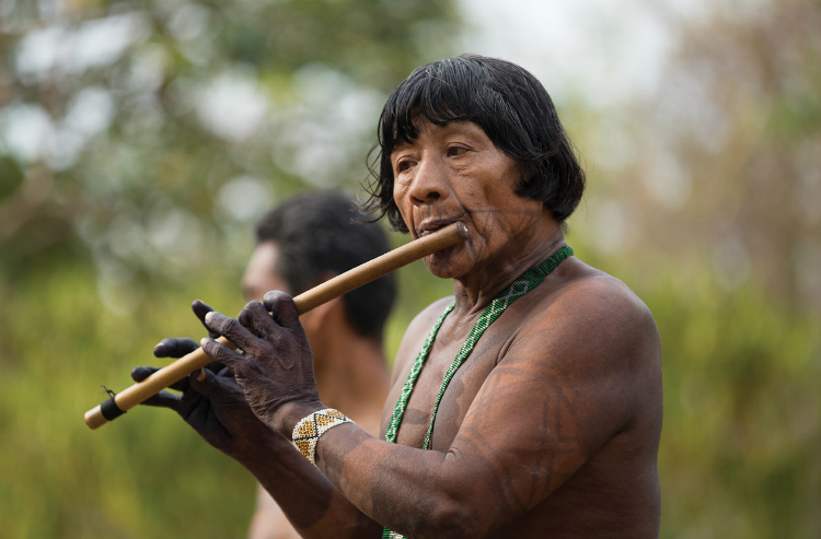 A tribal elder playing music in Central America