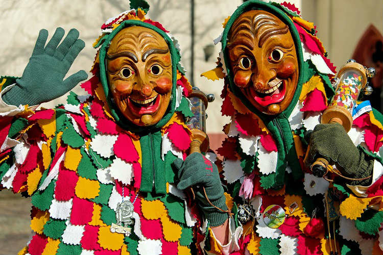 Colourful jesters in a Mardi Gras parade