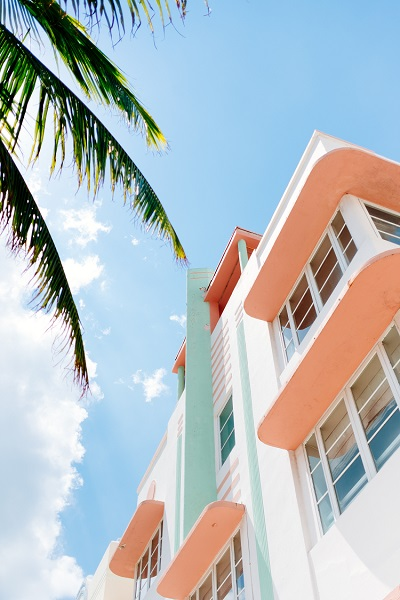 A pink and white art deco apartment building in Miami