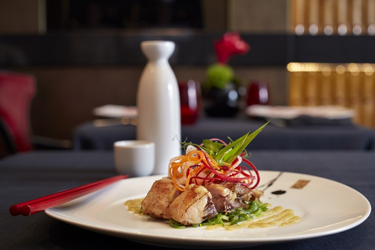 A plate of gourmet food in the Red Ginger restaurant on-board Oceania Riviera