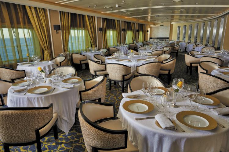 Elegantly set tables in the Chartreuse restaurant on-board Regent Seven Seas Voyager