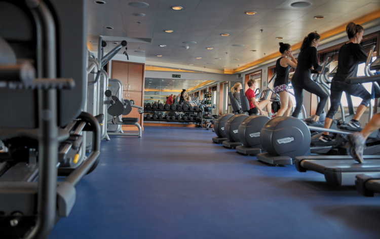 People using the cross trainers in the Fitness Centre on-board Regent Seven Seas Voyager