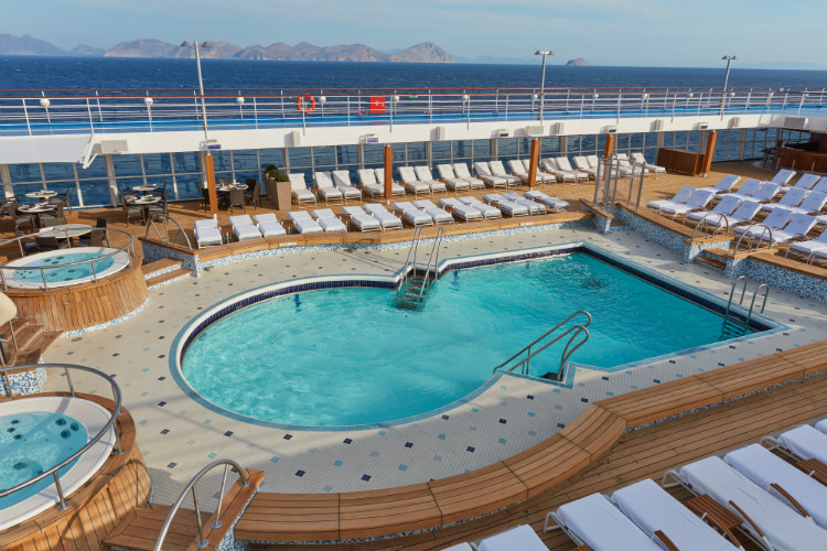 The spacious pool deck on-board Regent Seven Seas Voyager