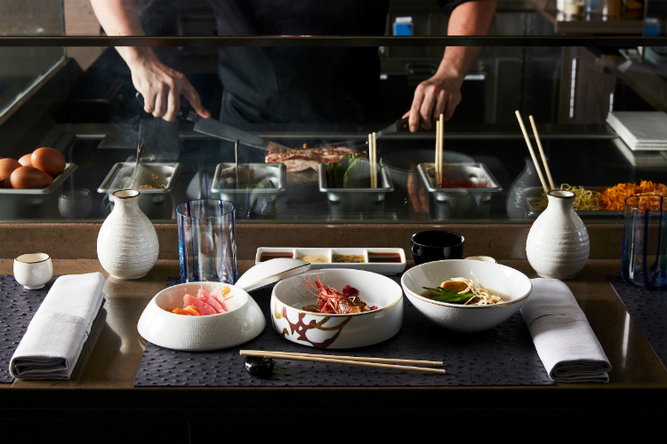 Chefs creating sushi and sashimi in the Kaiseki restaurant on-board Silver Muse