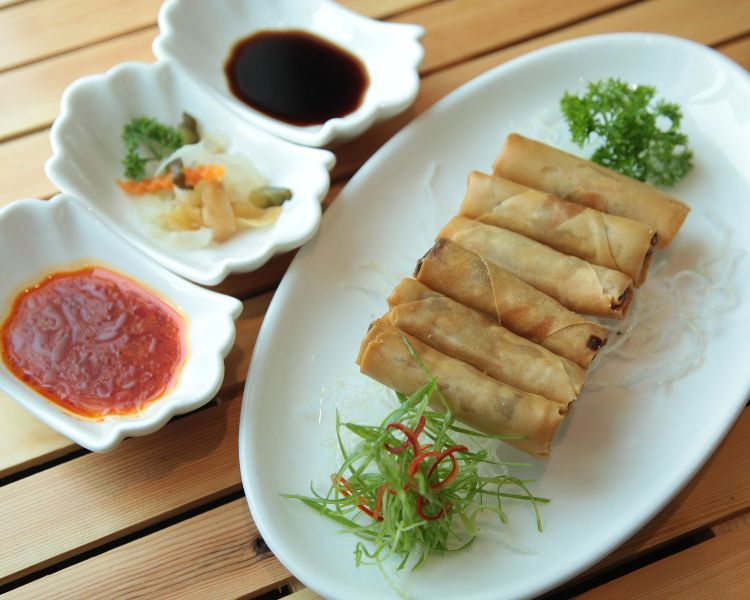 Spring rolls laid out on a table - often shared during Chinese New Year