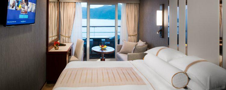 A sophisticated Club Veranda Stateroom on an Azamara cruise ship