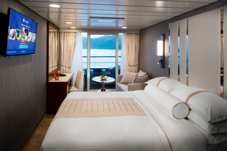 A sophisticated Club Veranda Stateroom on an Azamara cruise ship