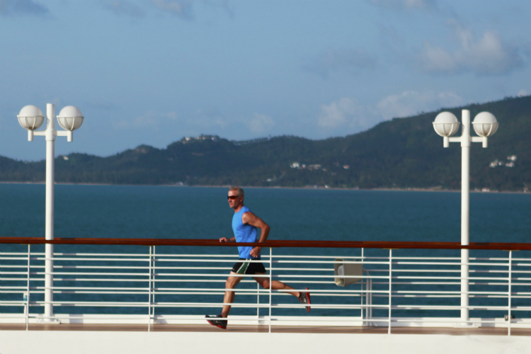 A guest using the jogging the track on an Azamara cruise