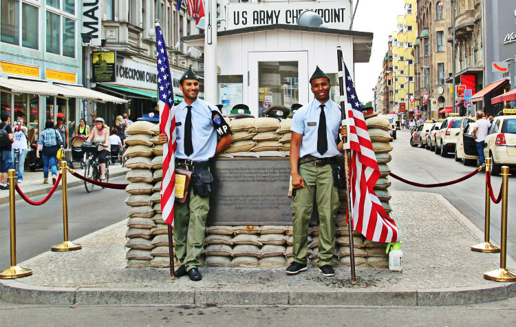 Actors standing at Checkpoint Charlie in Berlin