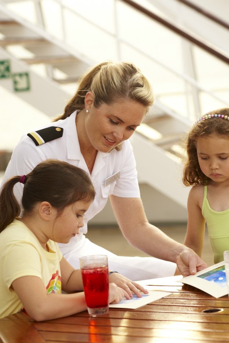 A Crystal Cruises officer taking part in on-board activities with kids
